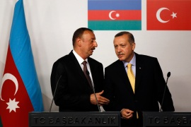Azerbaijan's President Ilham Aliyev (left) chats with Turkey's Prime Minister Recep Tayyip Erdogan during a news conference following a signing ceremony in Istanbul June 26, 2012 [File: Murad Sezer/Reuters]