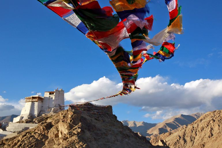 Buddhist prayer flags fly at Namgyal Tsemo Monastery above the town of Leh in Ladakh [Cathal McNaughton/Reuters]