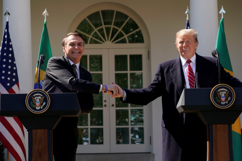 Weeks after Democrat Joe Biden defeated President Donald Trump in the United States election, Bolsonaro (left) still has not recognised Biden's victory [File: Kevin Lamarque/Reuters]