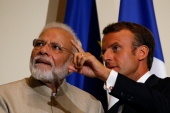 French President Emmanuel Macron gestures next to Indian PM Narendra Modi after a joint statement at the Chateau of Chantilly, near Paris, in this August 22, 2019 photo [File: Pascal Rossignol/Reuters]