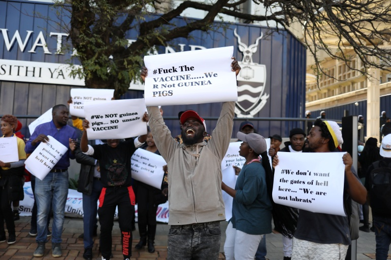 Protesters demonstrate against COVID vaccine testing on Africans, at Wits University [Reuters/Siphiwe Sibeko]