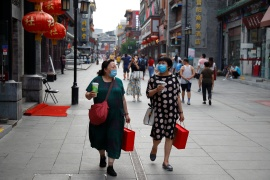 The rebound in consumer spending in China appears to have been uneven, relying on richer Chinese spending on luxury goods and holidays [File: Thomas Peter/Reuters]