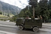 Indian army soldiers are seen atop a vehicle on a highway leading to Ladakh [Danish Ismail/Reuters]