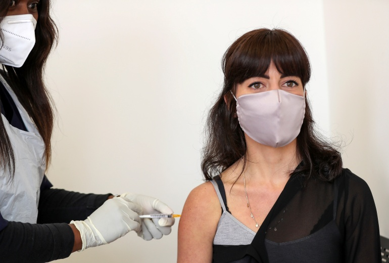 Robyn Porteous is injected with a vaccine as part of a clinical trial [Reuters/Siphiwe Sibeko]
