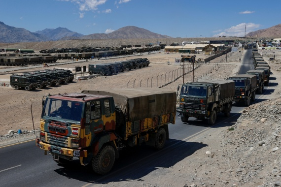 Indian army trucks carrying supplies move in convoy towards areas in the Ladakh region [Danish Siddiqui/Reuters]