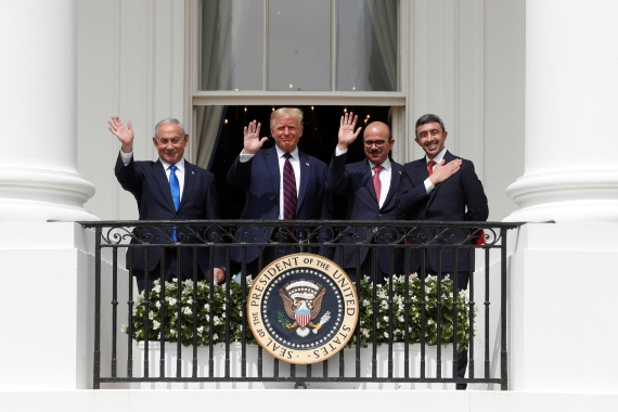 From left: Israel Prime Minister Benjamin Netanyahu, US President Donald Trump, Bahrain Foreign Minister Abdullatif Al Zayani and UAE Foreign Minister Abdullah bin Zayed wave from the White House balcony after signing the Abraham Accords [File: Tom Brenner/ Reuters]
