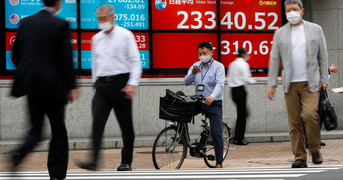 Vaccine bets push Asian shares higher, but risks remain