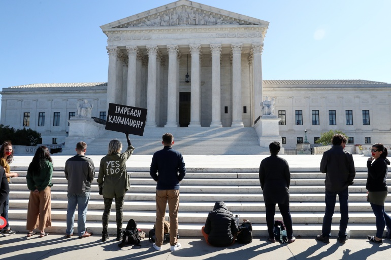 Activists gather outside the US Supreme Court as justices return to work for the first time since Ruth Bader Ginsburg's death, while Senate Republicans pursue quick confirmation of President Donald Trump's conservative nominee to replace her [Leah Millis/Reuters]