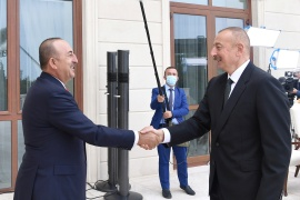 Azerbaijan's President Ilham Aliyev, right, shakes hands with Turkey's Minister of Foreign Affairs Mevlut Cavusoglu during a meeting in Baku, Azerbaijan October 6, 2020 [Official web-site of President of Azerbaijan/Handout via Reuters]