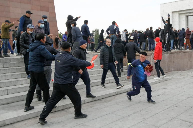 Demonstrators from rival political groups react during a rally in Bishkek, Kyrgyzstan, on October 9, 2020 [Vladimir Pirogov/Reuters]