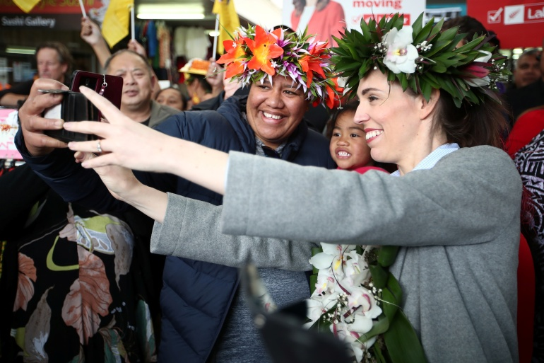 Supporters line up for selfies with New Zealand Prime Minister Jacinda Ardern as she campaigns in Auckland [Fiona Goodall/Reuters]