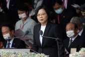 Taiwan President Tsai Ing-wen called for 'meaningful dialogue' with China as she addressed told people at the island's National Day celebrations [Ann Wang/Reuters]