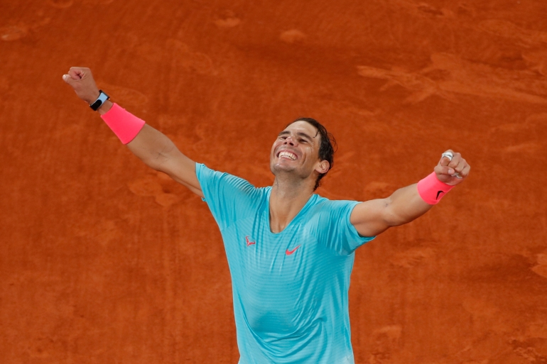 Rafael Nadal celebrates after winning the French Open final against Novak Djokovic [Gonzalo Fuentes/Reuters]