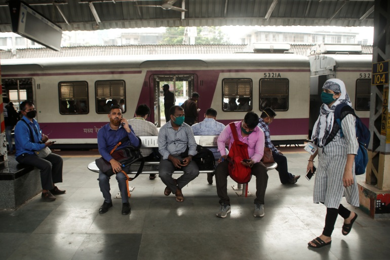 Commuters wait on a railway platform after train services were interrupted during a power outage in Mumbai [Francis Mascarenhas/Reuters]