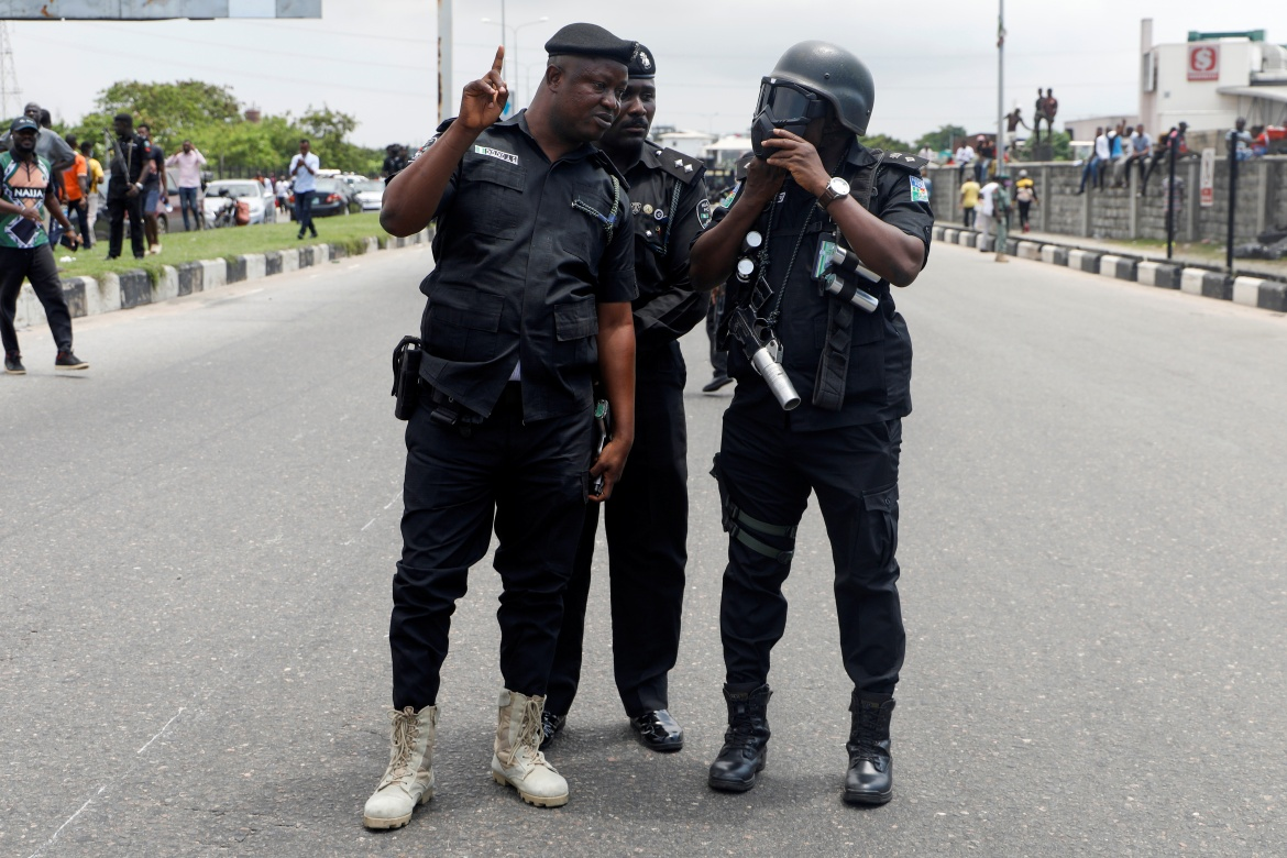 After days of angry protests, the president's office and the police chief announced on Sunday the dissolution of SARS with immediate effect. They also said all SARS officers would be redeployed to other police units. [Temilade Adelaja/Reuters]