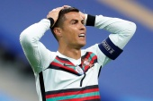 The Portuguese Football Federation says Cristiano Ronaldo 'is doing well, without symptoms, and is in isolation' [File: Gonzalo Fuentes/Reuters]