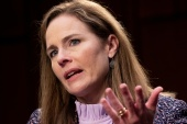 Judge Amy Coney Barrett is expected to be confirmed on Monday [File: Michael Reynolds/Reuters]