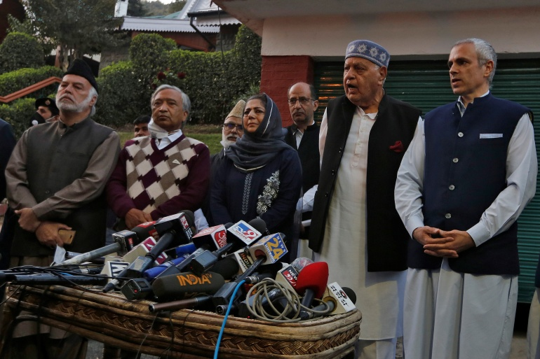 Indian-administered Kashmir leaders address the media after their meeting in Srinagar [Danish Ismail/Reuters]