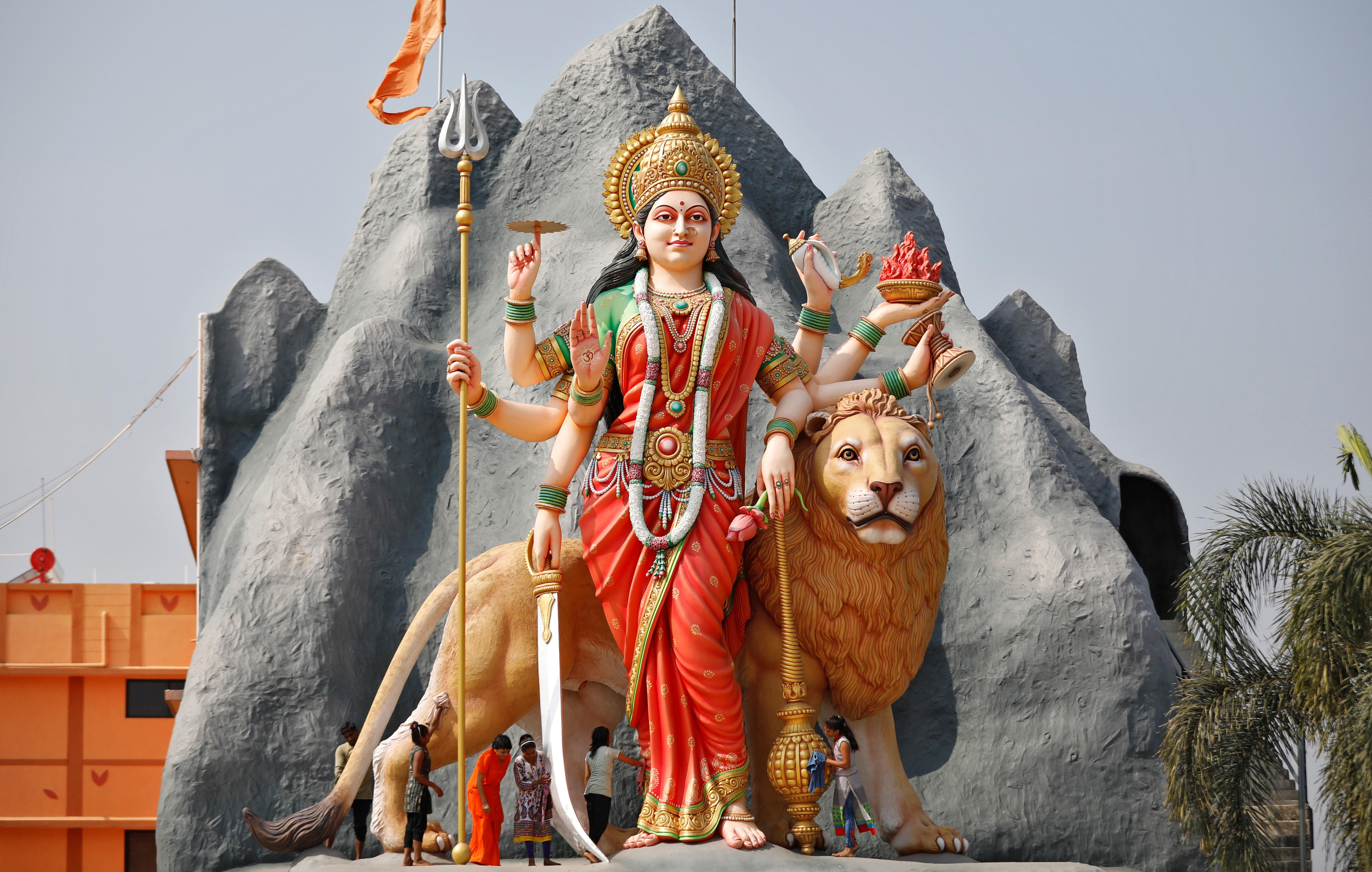 Girls clean a 34-foot tall idol of Hindu goddess Durga at a temple in Gandhinagar Gujarat