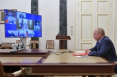 Russia's President Vladimir Putin takes part in a video conference call with members of the Security Council in Moscow, Russia [Sputnik/Alexei Druzhinin/Kremlin via Reuters]