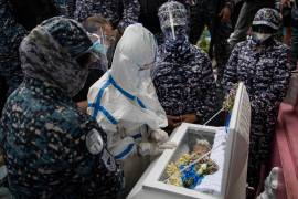 Heavily armed prison officials guarding Nasino refused to uncuff her despite her repeated pleas, as she said goodbye to her baby [Eloisa Lopez/Reuters]