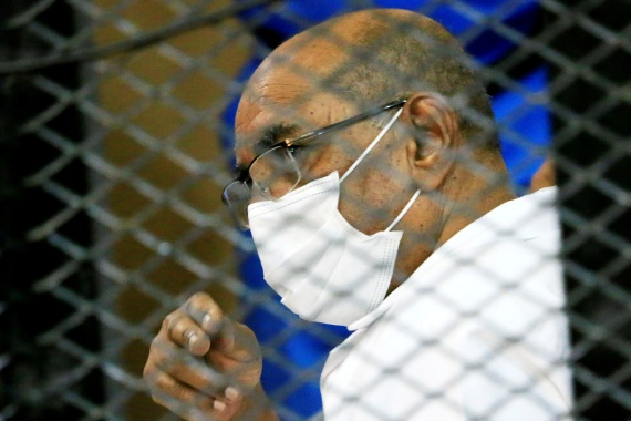 Sudan's overthrown President Omar al-Bashir is seen inside the defendant's cage during his and some of his former allies' trial over the 1989 military coup that brought him to power [File: Mohamed Nureldin Abdallah/Reuters]