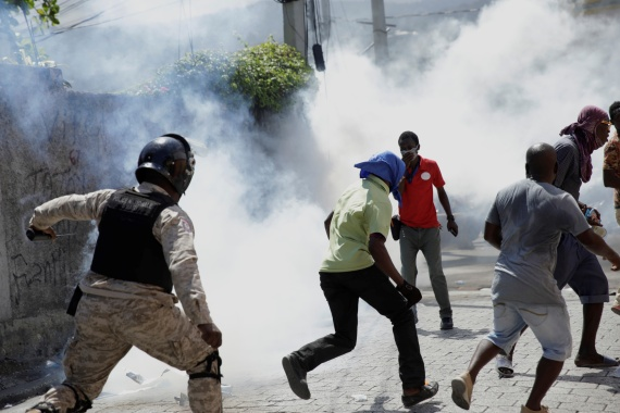 Haitian police fired rubber bullets and tear gas to disperse anti-government protesters. [Andres Martinez Casares/Reuters]