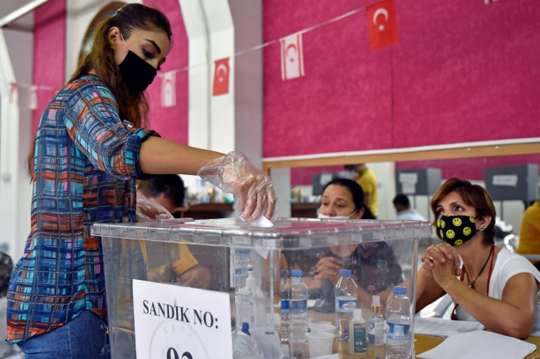 A woman casts her vote during Turkish Cypriot presidential election in Nicosia [Harun Ucar/Reuters]