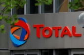Total has been accused of intimidating and failing to properly compensate local landowners affected by work on its Tilenga project in Uganda [File: Charles Platiau/Reuters]