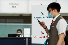 The coronavirus pandemic pushed Cathay Pacific into survival mode, forcing it to cut capacity and offer its staff voluntary no-pay leave [Lam Yik/Reuters]
