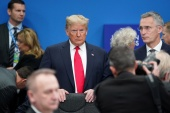 US President Donald Trump stands among other leaders as he attends a plenary session at the NATO summit in Watford, near London, UK, on December 4, 2019 [File: Kevin Lamarque/Reuters]