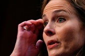 Judge Amy Coney Barrett is poised to become President Donald Trump's third justice appointed to the United States Supreme Court [Andrew Caballero-Reynolds/Pool via Reuters]