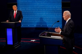 Joe Biden answers a question as Donald Trump listens during the second and final presidential debate at Belmont University in Nashville, Tennessee, October 22, 2020. [Morry Gash/Pool via REUTERS]