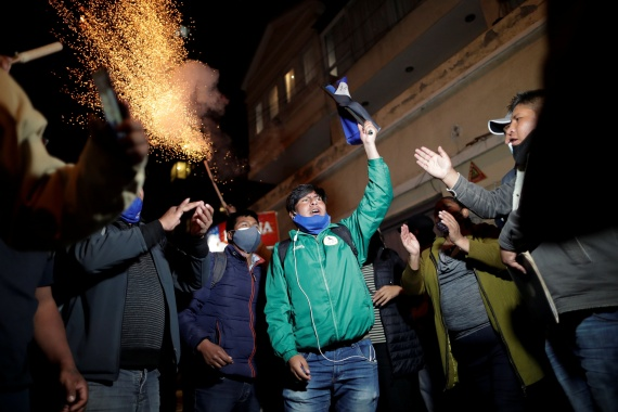 Luis Arce's supporters celebrate his landslide victory in front of his house in La Paz [Ueslei Marcelino/Reuters]