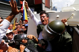 In this file photo from 2014, Venezuelan opposition leader Leopoldo Lopez gets into a National Guard armoured vehicle in Caracas [File: Jorge Silva/Reuters]
