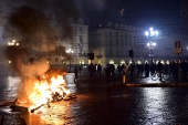 A fire is seen as people protest against the new restrictions introduced by the government to curb the coronavirus disease in Turin [Massimo Pinca/Reuters]