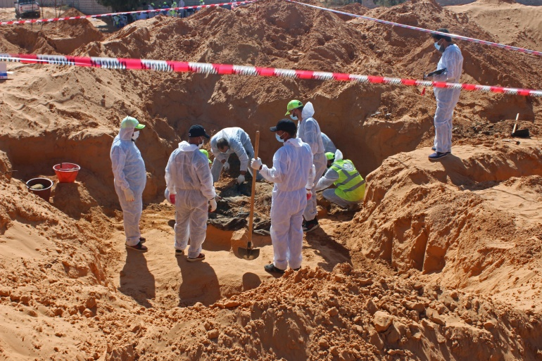 A committee official, Tawfiq, told AFP journalists a total of 98 bodies had now been found since searches of mass graves were launched after the withdrawal of Haftar's forces from western Libya in June. [Ayman Al-Sahili/Reuters]
