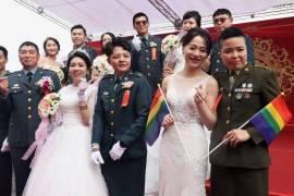 This year's pride march also comes on the heels of another milestone for Taiwan as same-sex couples took part on Friday for the first time ever in a mass military wedding ceremony [Ann Wang/Reuters]
