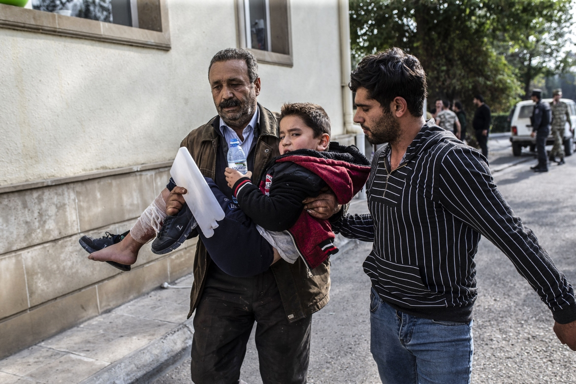 A wounded child being taken to hospital after attacks on the city centre of Azerbaijan's Barda. [Arif Hüdaverdi Yaman/Anadolu]