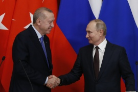 Turkish President Recep Tayyip Erdogan and Russia's President Vladimir Putin shake hands at the end of a joint news conference following a meeting at the Kremlin Palace in Moscow, Russia on March 5, 2020 [Sefa Karacan/Anadolu Agency]