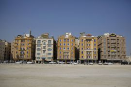 Saudi Arabia's housing minister says the cut in real estate transaction costs would help achieve a target of boosting housing ownership among Saudis to 70 percent [File: Simon Dawson/Bloomberg]