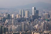 Seoul apartment prices have risen more than 50 percent since the left-leaning President Moon Jae-in inherited loosened mortgage rules from the previous administration three years ago [File: SeongJoon Cho/Bloomberg]
