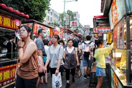 Taiwan's economy has escaped the ravages of the coronavirus relatively lightly, helped by surging electronics exports to mainland China [File: I-Hwa Cheng/Bloomberg]