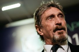 US market regulators also accuse John McAfee of promoting the sale of cryptocurrencies without disclosing that he was being paid to do so [File: Anthony Kwan/Bloomberg]