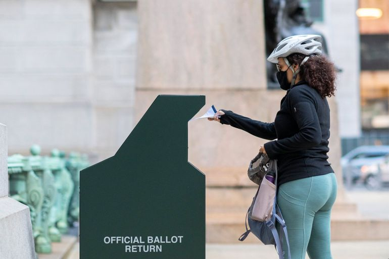 A voter casts her early voting ballot at a drop box outside of City Hall on October 17, 2020 in Philadelphia, Pennsylvania, the United States [File: Mark Makela/Getty Images]