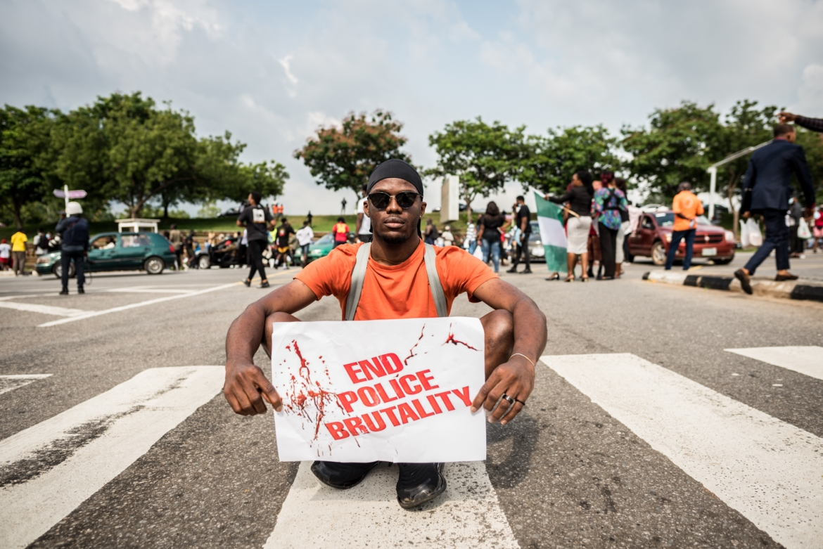 "Tucker Okolo, 26, chef: ""As a young man in Nigeria, I live in constant fear of the police because I am often profiled wrongly by some of the officers. I joined the protest because I want to ensure that SARS is scrapped. I want the police to be reformed, and the right people to be employed for the job."" [Etinosa Yvonne/Al Jazeera]"