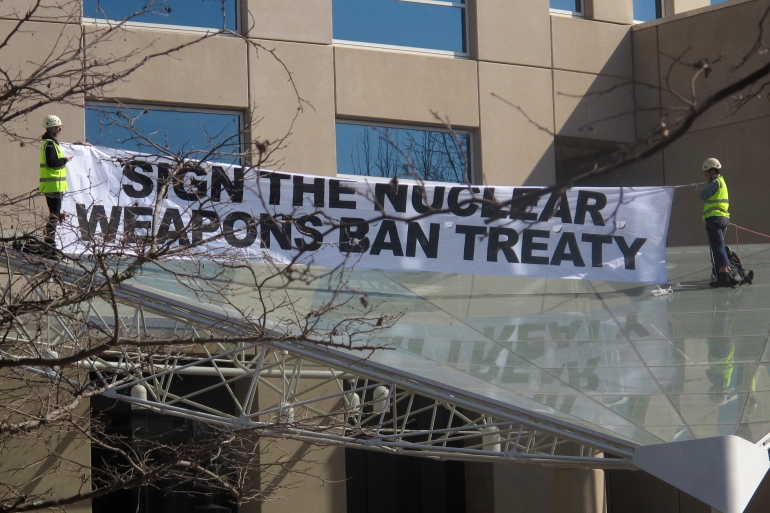 The treaty requires ratifying countries to 'never ... develop, test, produce, manufacture, otherwise acquire, possess or stockpile nuclear weapons or other nuclear explosive devices' [File: Rod McGuirk/ AP]