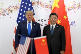 President Donald Trump, left, poses for a photo with Chinese President Xi Jinping during a meeting on the sidelines of the G20 summit in Osaka, Japan, on Saturday, June 29, 2019 [AP Photo/Susan Walsh]