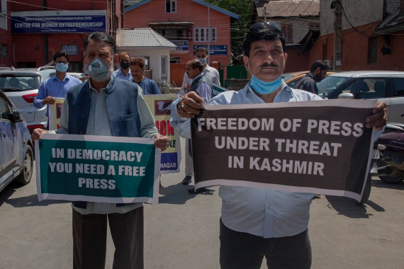 Kashmiri journalists protest in Srinagar against a new media policy announced this year that seeks to regulate reporting in the disputed region [File: Dar Yasin/AP]
