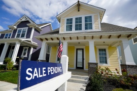 Though 23 million Americans are collecting unemployment benefits, the housing market remains red hot, with sales of existing homes rising to levels not seen since the housing bubble peak in 2006 [File: Michael Conroy/AP]